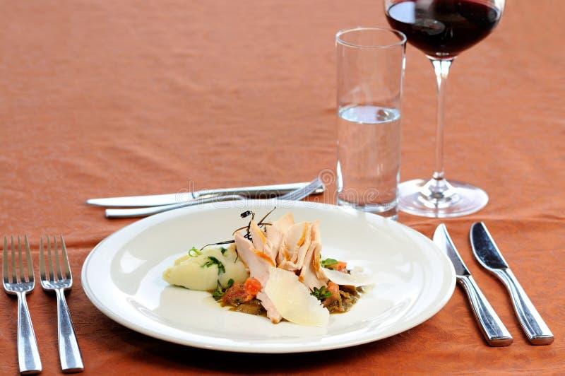 Köttmål med rött vin arkivfoto