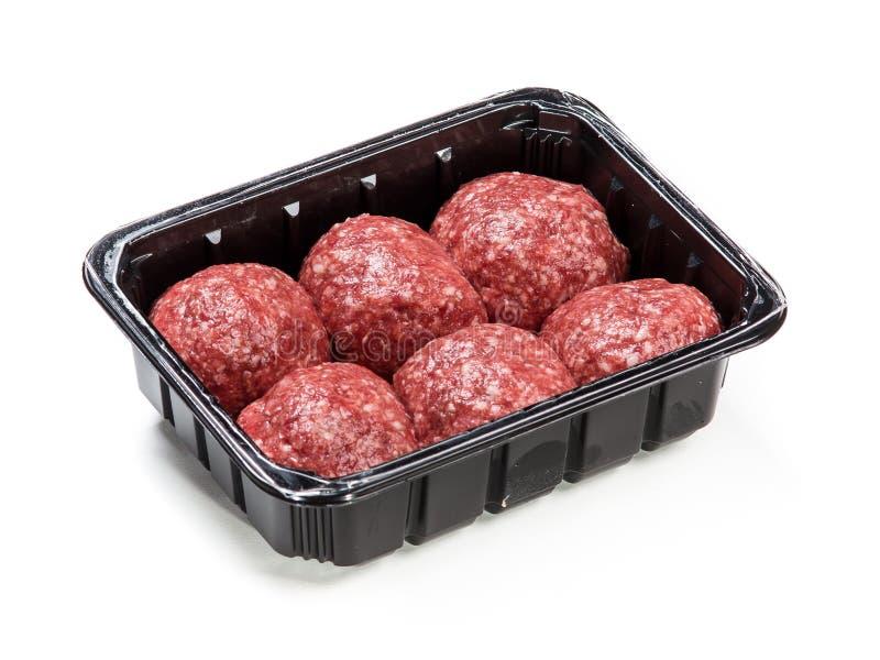 Köttmeatprodukten för matlagning packade i ask royaltyfria bilder
