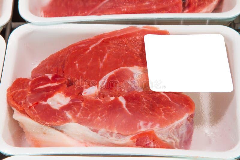 Köttskivor i askar royaltyfri fotografi