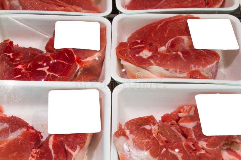 Köttskivor i askar royaltyfria bilder