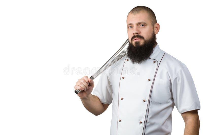 Küche bearbeitet Konzept Koch mit ernster Gesichtsholding wischen auf der Schulter Chef mit dem Peitschen des Geräts Mann oder Hi lizenzfreies stockbild