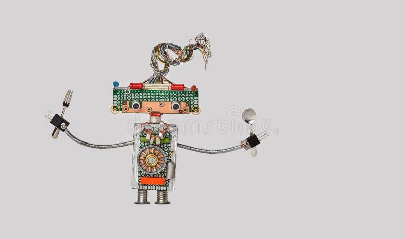 Küchenchef kochend, gabeln Sie und löffeln Sie in den Armen Lustiger Spielzeugroboter für Restaurantlebensmittelmenü-Werbungsplak lizenzfreie stockbilder