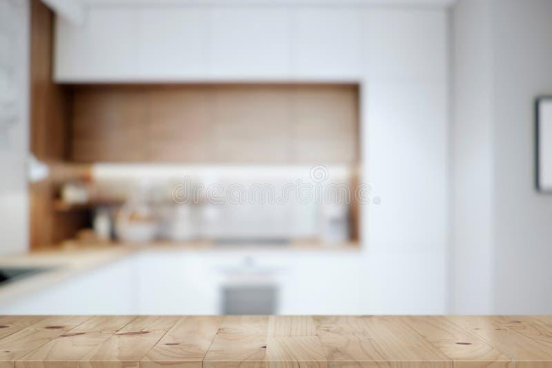Küchentischspitze und Unschärfehintergrund des Kochens des Zoneninnenraums lizenzfreie stockbilder
