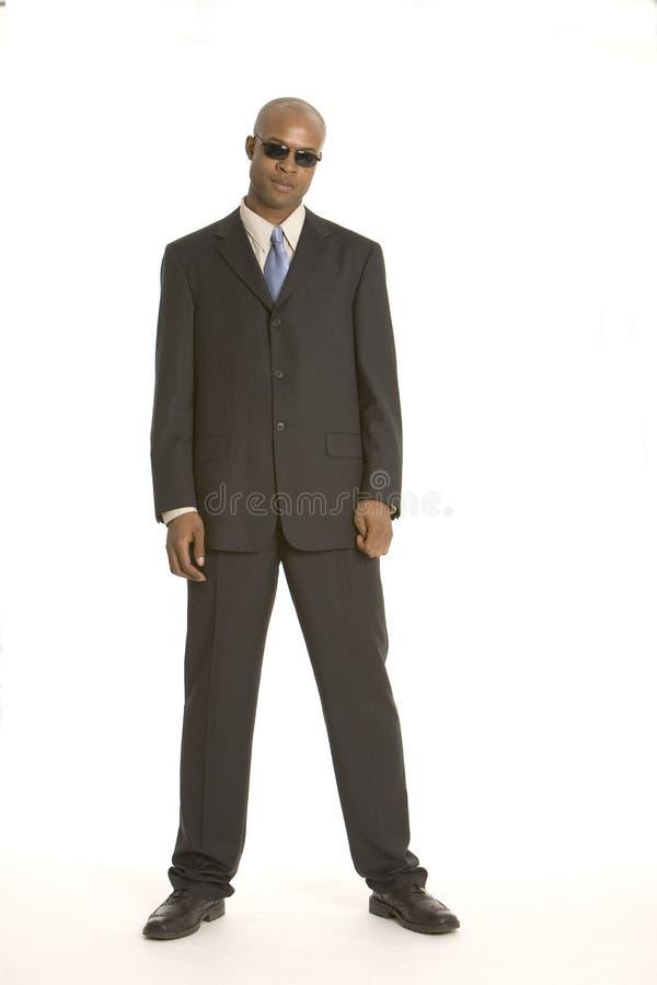 Kühler Kerl in einer Klage lizenzfreie stockbilder