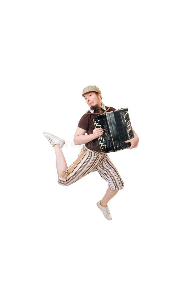 Kühler Musiker, der hoch springt lizenzfreies stockfoto