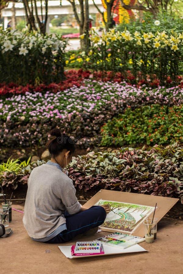 Künstler im Blumen-Festival lizenzfreie stockbilder
