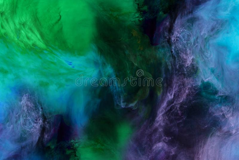 künstlerische Beschaffenheit mit blauer, purpurroter und grüner Farbe wirbelt Aussehung wie Raum lizenzfreies stockfoto