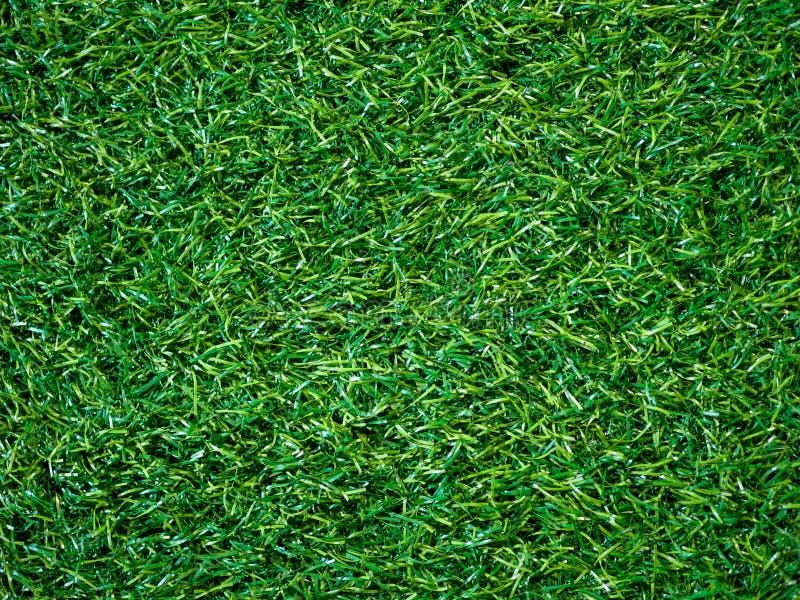 Künstliche Hintergrundbeschaffenheit des grünen Grases auf Fußballplatz- und Kopienraum für Entwurf in Ihrer Arbeit stockbilder