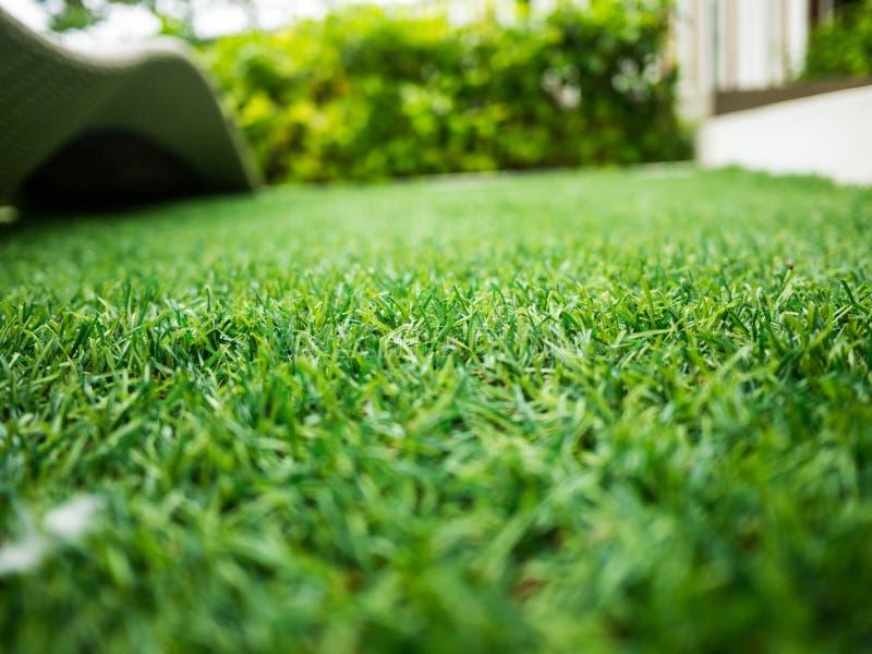 Künstlicher Beschaffenheitshintergrund des grünen Grases stockfotos