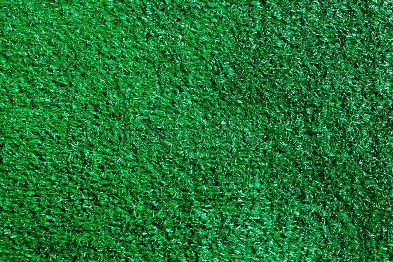 Künstlicher strukturierter Hintergrund des grünen Grases stockbilder