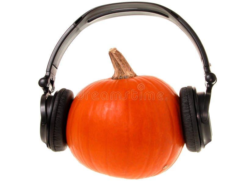 Kürbis-Kopf mit Kopfhörern (1 von 2) stockbild