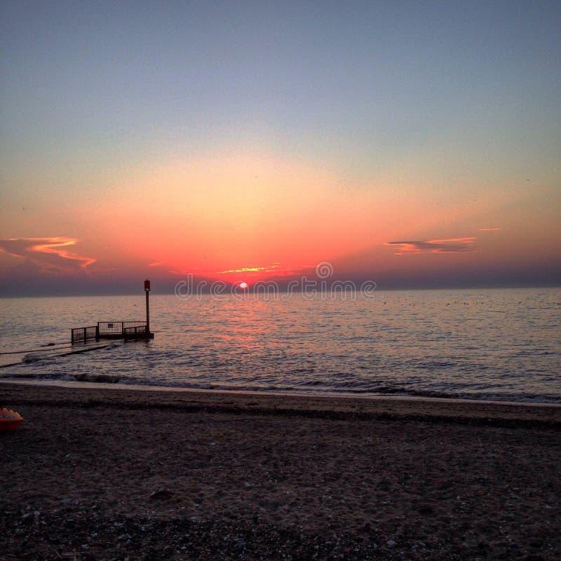 Küste-Sonnenuntergang Devon lizenzfreie stockfotografie