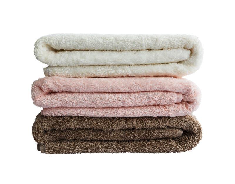Kąpielowi ręczniki w stercie odizolowywającej obrazy stock