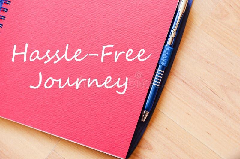 Kłopot bezpłatna podróż pisze na notatniku zdjęcie royalty free