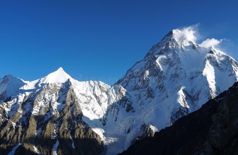 K2 κορυφή 8848 μ επάνω από τη θάλασσα - δεύτερη υψηλότερη αιχμή επιπέδων στον κόσμο που τοποθετείται στη σειρά βουνών Karakoram σ στοκ φωτογραφίες