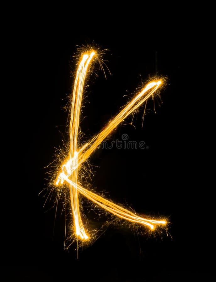 K de peinture léger sur le fond noir photos libres de droits