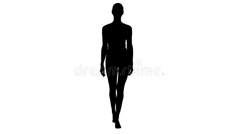 走在白色体育女用贴身内衣裤和微笑的剪影夫人 库存图片