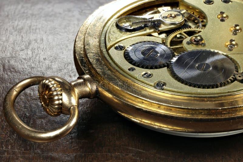 14k gold pocket watch. Clockwork of an antique Swiss 14k gold pocket watch stock images