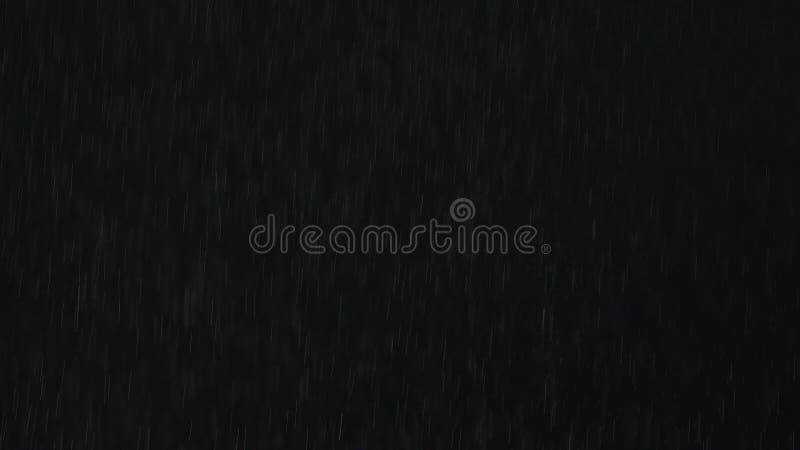 4k Heavy angled rain falling in front of the camera against black screen. Raindrops splashing. Rain closeup vfx insert stock photos