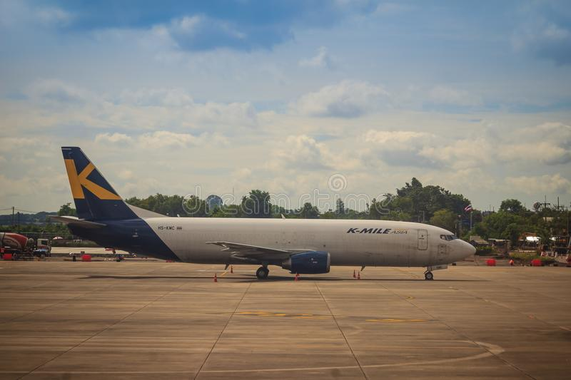 K-Mile Asia airplane is parking at the airport. K-Mile Air is a cargo airline to provide both scheduled- and charter cargo flights royalty free stock image