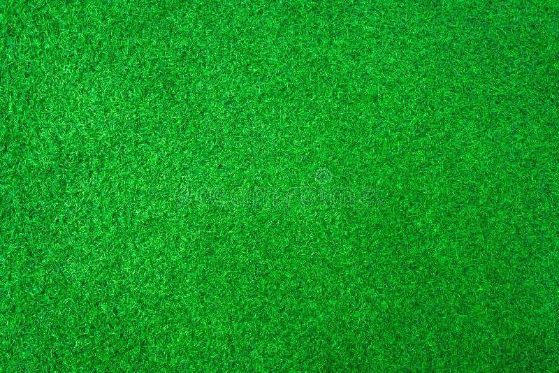 K?nstlicher gr?nes Gras- oder Sportfeldbeschaffenheitshintergrund stockbild
