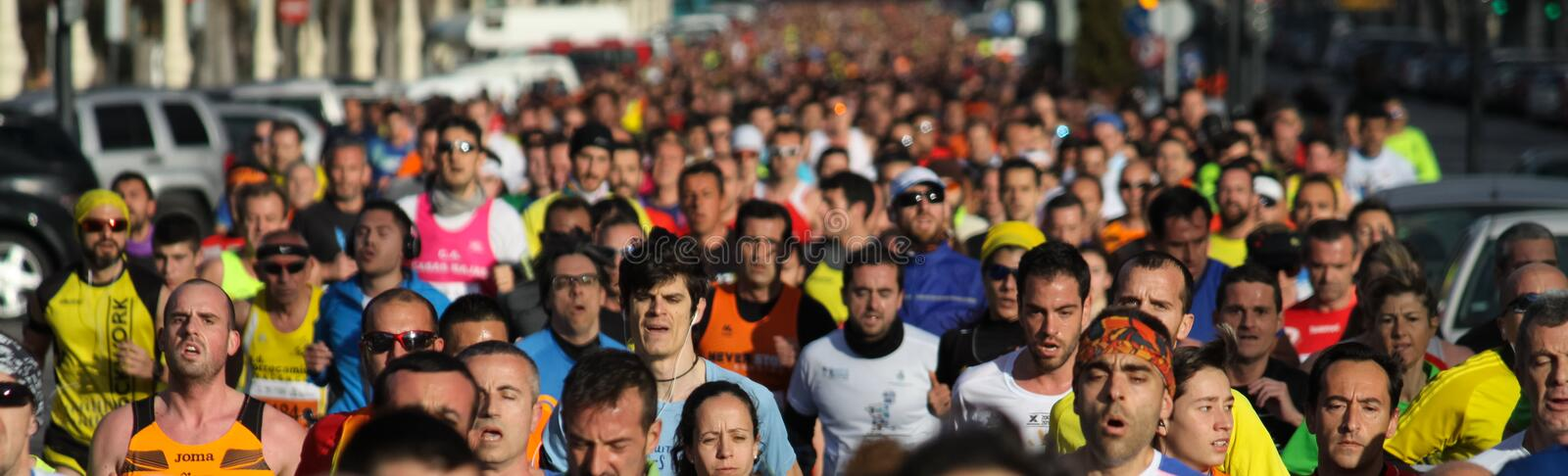 5K Run. VALENCIA, SPAIN - FEBRUARY 22, 2015: Runners compete in the IV University of Valencia 5K run in the streets of Valencia stock photo
