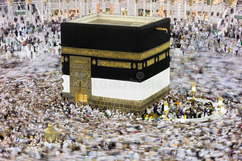 Kaaba in Mecca Saudi Arabia at Night. Muslim pilgrims, from all around the World, revolving around the Kaaba at night during Hajj in Saudi Arabia stock photos
