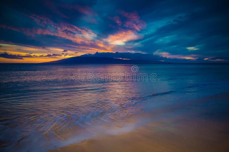 Kaanapali beach Sunset on Maui. Looking towards Lanai off the Kaanapali beach at sunset on the island of Maui royalty free stock image