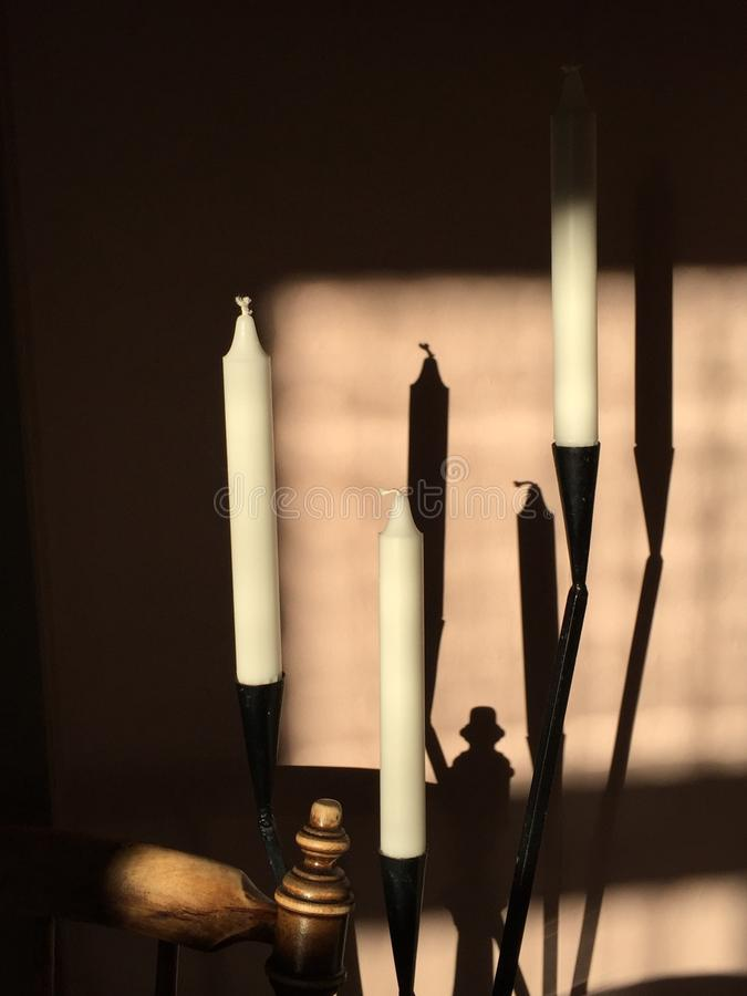 Kaarsen en schaduwen stock foto