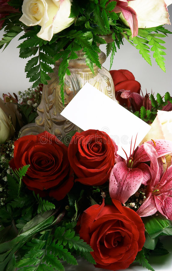 Kaart en bloemen stock foto's