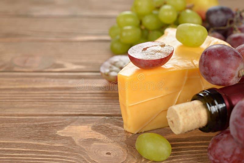 Kaas en druiven stock foto