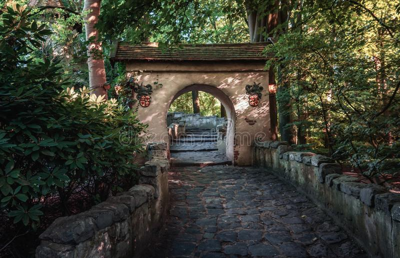 The entrance gate to the castle of Sleeping Beauty in the fairytale forest in the theme park Efteling. Kaatsheuvel, Netherlands, August 19 , 2017: The entrance stock image