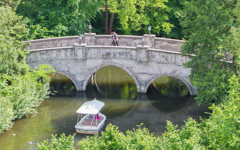 KAATSHEUVEL/THE NETHERLANDS - MAY 23th, 2014: Efteling park ride. Boat with visitors, sails under an old brigde stock photos