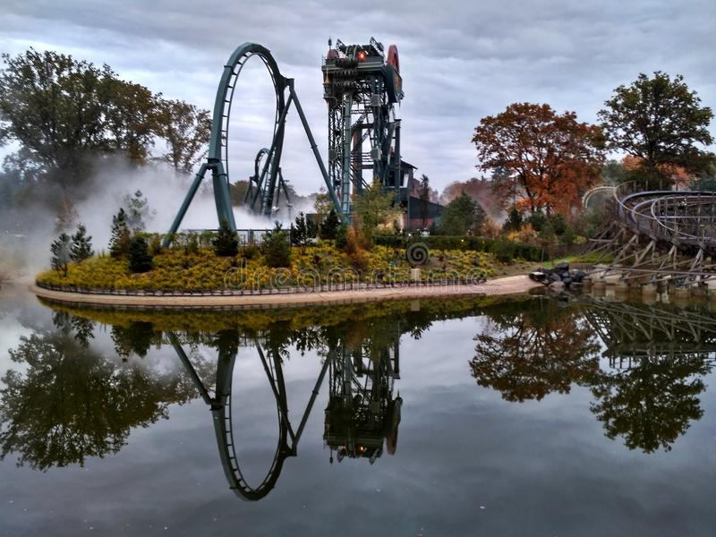Kaatsheuvel / The Netherlands - November 03 2016: Speed roller coaster Baron 1898 in action in Theme Park Efteling. Symmetric royalty free stock photo