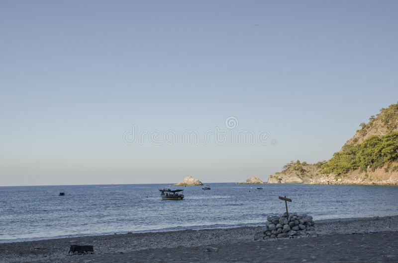 Kabak海滩,火鸡,在海滩的早晨,太阳阐明海滩的部分 免版税图库摄影