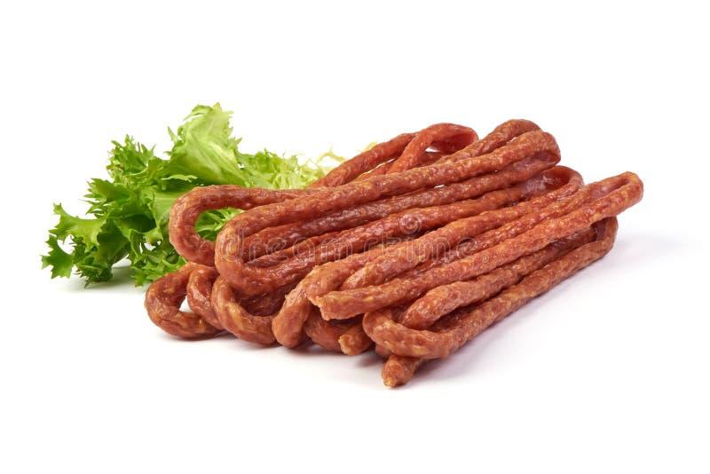 Kabanos Longue saucisse sèche mince polonaise faite de porc D'isolement sur le fond blanc image libre de droits