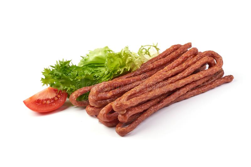 Kabanos. Polish long thin dry sausage made of pork. Isolated on white background.  stock image