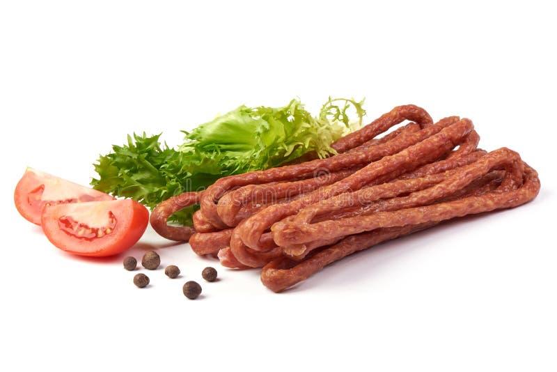 Kabanos. Polish long thin dry sausage made of pork. Isolated on white background.  stock photography