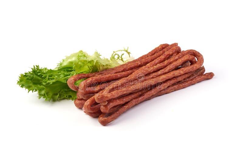 Kabanos. Polish long thin dry sausage made of pork. Isolated on white background.  royalty free stock photography