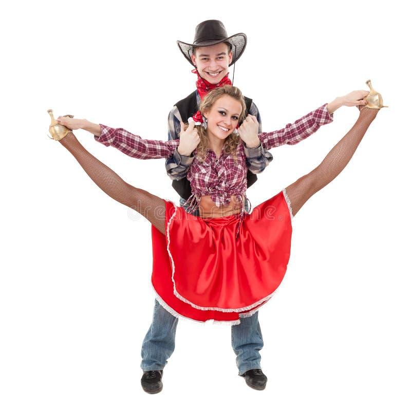 Kabaretowa tancerz para ubierająca w kowbojskich kostiumach fotografia stock