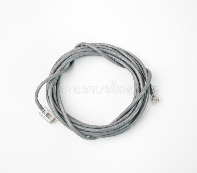 Kabel för nätverk för lappkabel med den göt proppen som RJ45 isoleras på en vit bakgrund royaltyfria foton