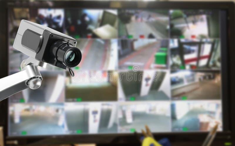 Kabeltelevisie-de monitor van de veiligheidscamera in de bureaubouw stock fotografie