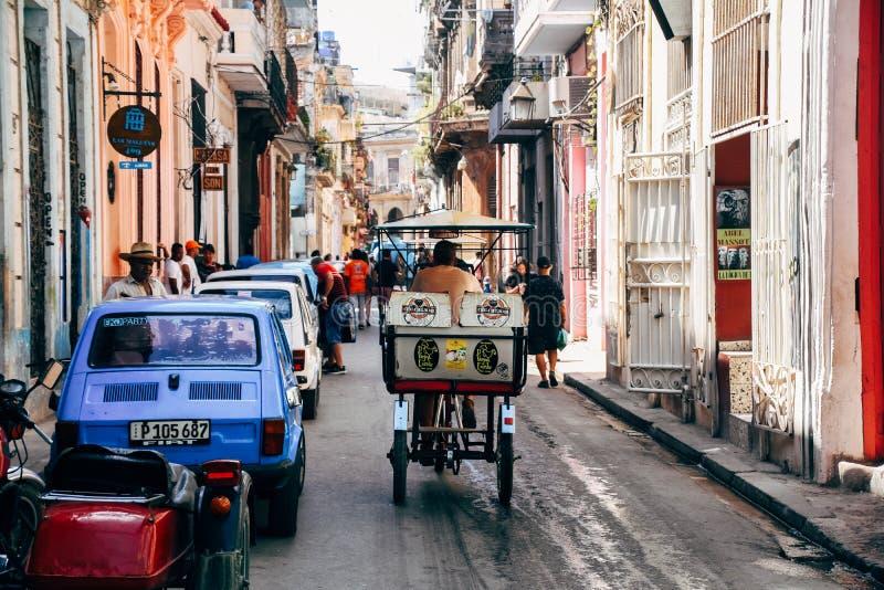 A kabuki taxi driving down the street of Trinidad, Cuba. A kabuki taxi driving down the shady street of Trinidad, Cuba royalty free stock photo