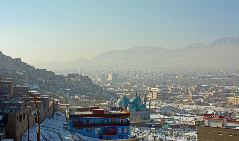 Kabul, Afghanistan. A view from the side of a hill looking out over a very hazy and populated Kabul, Afghanistan royalty free stock photos