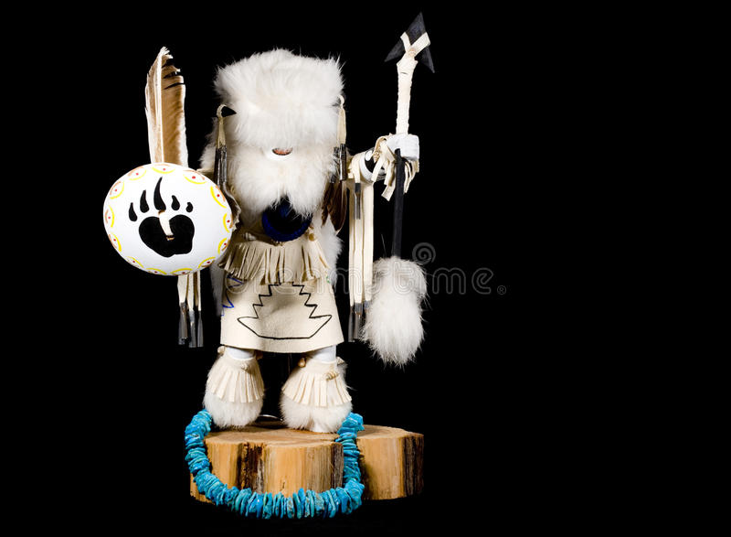 Kachina Doll - Buffalo Warrior. A White Buffalo Warrior Kachina doll on black background. The Buffalo Warrior is second to the most powerful warrior amongst the royalty free stock image