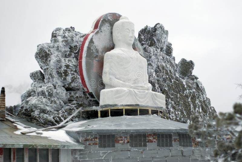 Unfinished statue of Buddha in the monastery of Shad Tchup Ling in the Ural Mountains. KACHKANAR, RUSSIA - JANUARY 09, 2018: unfinished in the process of royalty free stock photo