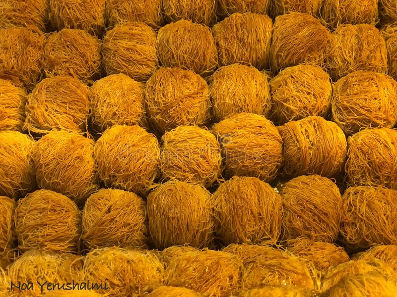 Kadaif Sweets. Middle Eastern dessert . Kadaif noodles are a type of thin Turkish noodles. They are made ​​of flour and water that is poured royalty free stock images