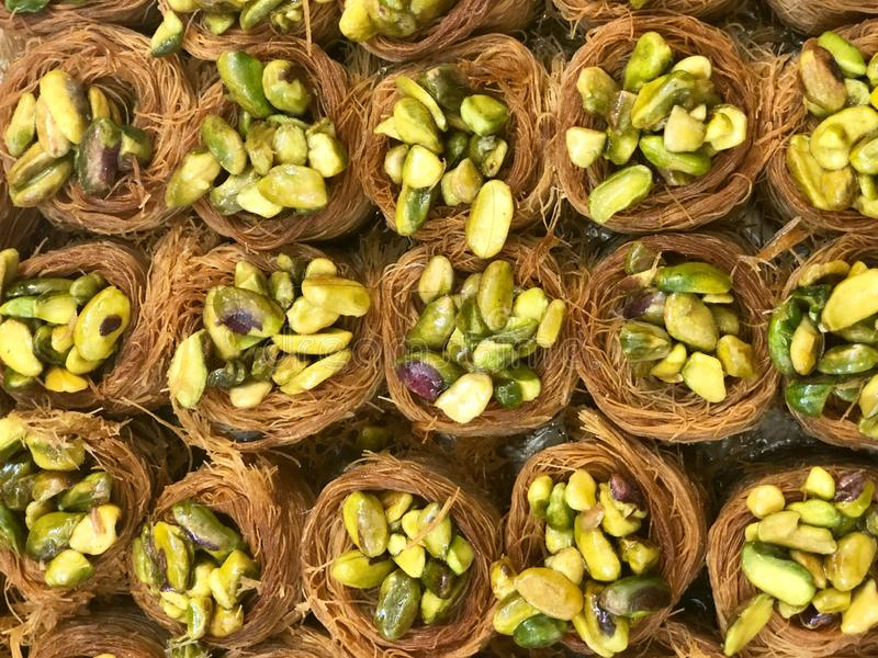 Kadaif Sweets . Arabic dessert . Baklava. Kadaif noodles are a type of thin Turkish noodles. They are made ​​of flour and water that is poured stock image