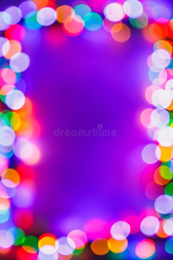 Kader van Kerstmis bokeh het veelkleurige lichten stock foto