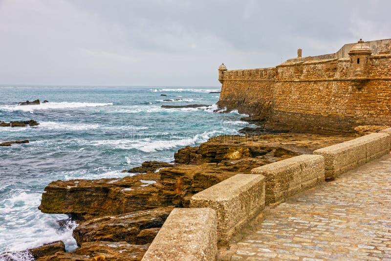 Kadiz beach, San Sebastian fortress, Spain stock image